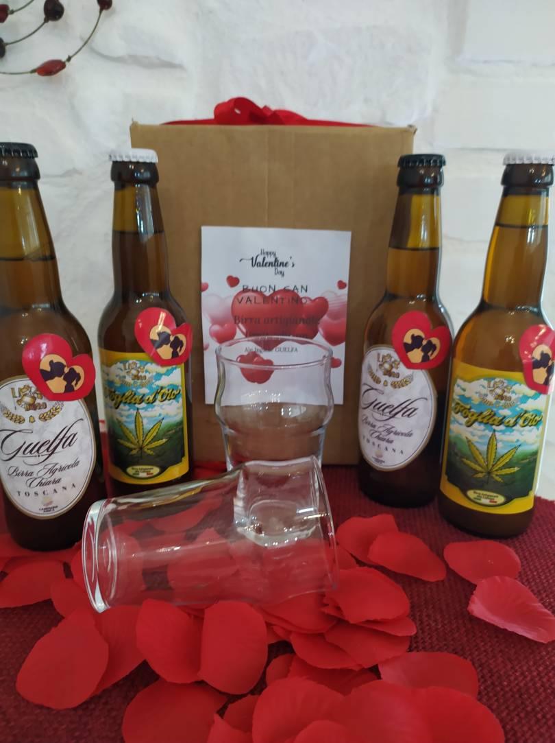 immagine di quattro birre di san valentino in un tavolo allestito con cuoricini di carta